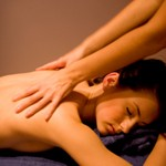 Woman receiving a relaxing back massage.
